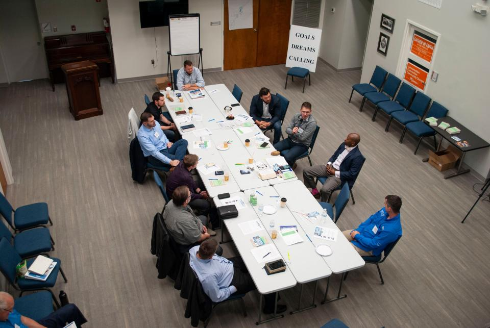 Group of Young Professionals meeting around a table